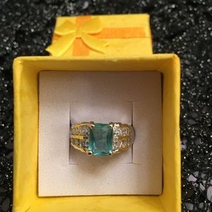 Aquamarine with cz's set in sterling Silver.